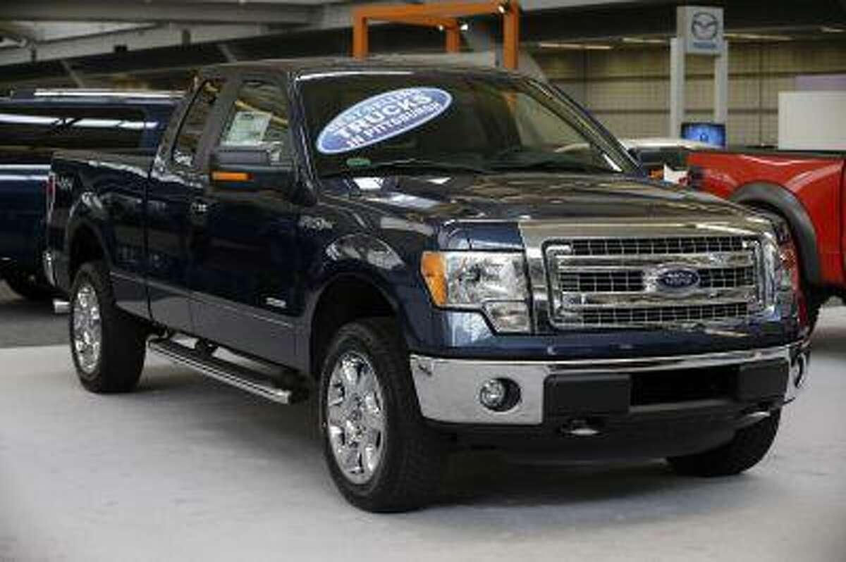 This photo taken on Feb. 14, 2013 shows a 2013 Ford F-150 truck on display at the 2013 Pittsburgh Auto Show in Pittsburgh. (AP Photo/Gene J. Puskar)