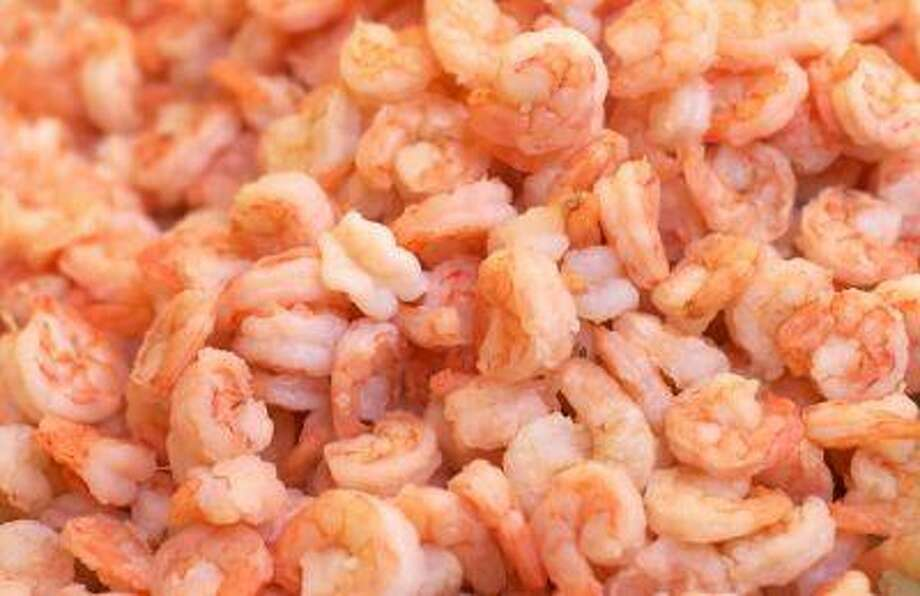Chef John Broening suggests peeling and deveining raw shrimp, then pouring a boiling court bouillon over the shrimp and covering them with plastic wrap. Photo: Getty Images/iStockphoto / iStockphoto