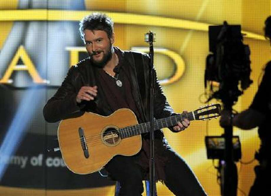 In this April 7, 2013 file photo, singer Eric Church performs at the 48th Annual Academy of Country Music Awards at the MGM Grand Garden Arena in Las Vegas. Photo: Chris Pizzello/Invision/AP / Invision