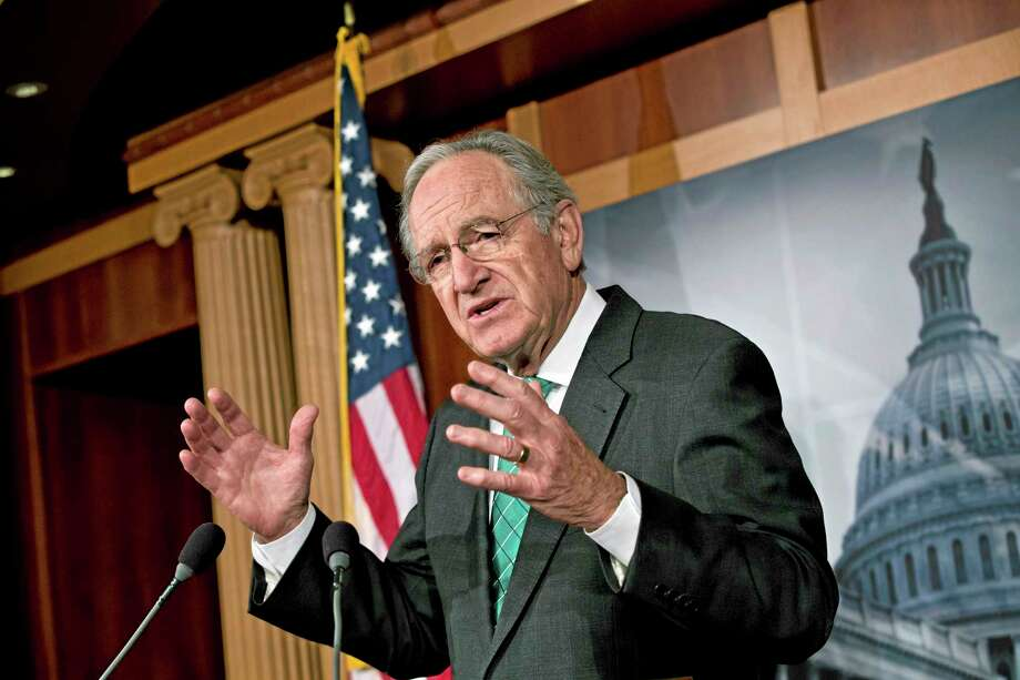 Sen. Tom Harkin, D-Iowa, chairman of the Health, Education, Labor, and Pensions Committee, talks to reporters after the Senate cleared a major hurdle and agreed to proceed to debate a bill that would prohibit workplace discrimination against gay, bisexual and transgender Americans, at the Capitol in Washington, Monday, Nov. 4, 2013. The bipartisan vote increases the chances that the Senate will pass the bill by week's end, but its prospects in the Republican-led House are dimmer. (AP Photo/J. Scott Applewhite) Photo: AP / AP