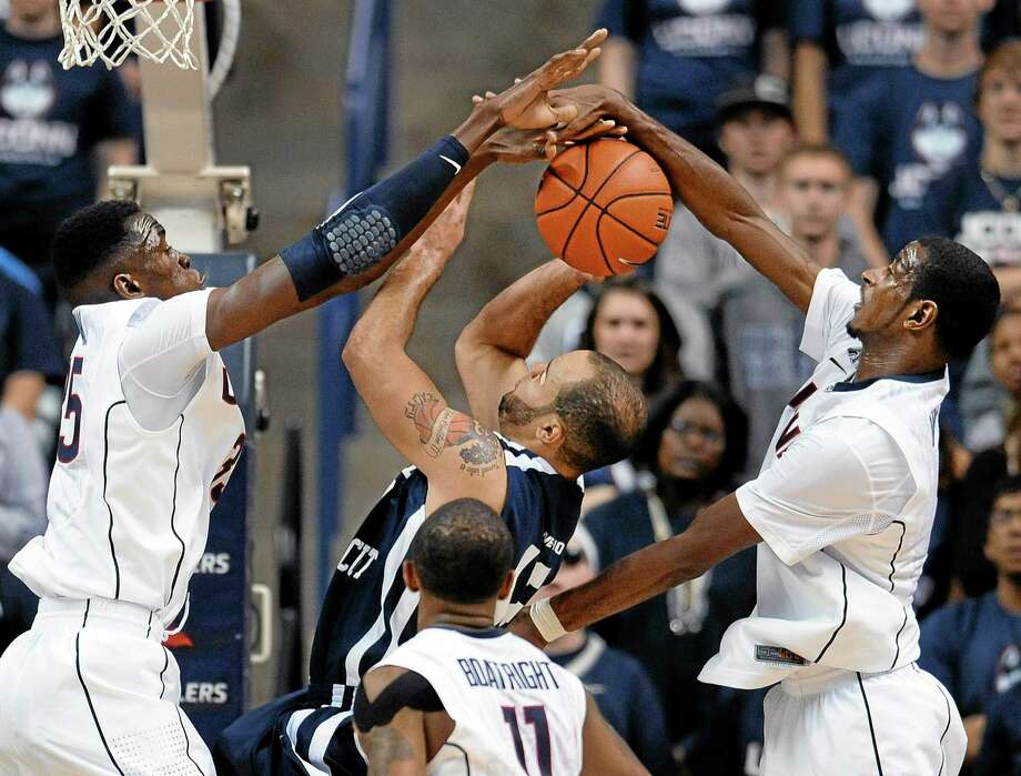 UConn's Amida Brimah, left, and DeAndre Daniels, right, block Southern Connecticut State's Tylon Smith, center, during an exhibition game on Wednesday. Photo: Jessica Hill — The Associated Press  / FR125654 AP
