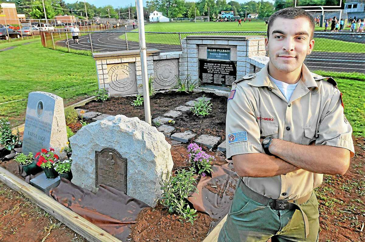 Middletown resident Michael Tewksbury, 17, a member of Boy Scouts Troop 16 chartered by Third Congregational Church, at the site of his Eagle Scout Service Project, the monument area at Miller-Fillback Veterans Memorial Field. Tewksbury, a rising freshman at Norwich University, plans to study computer science and is enrolled in the ROTC program. Catherine Avalone — The Middletown Press