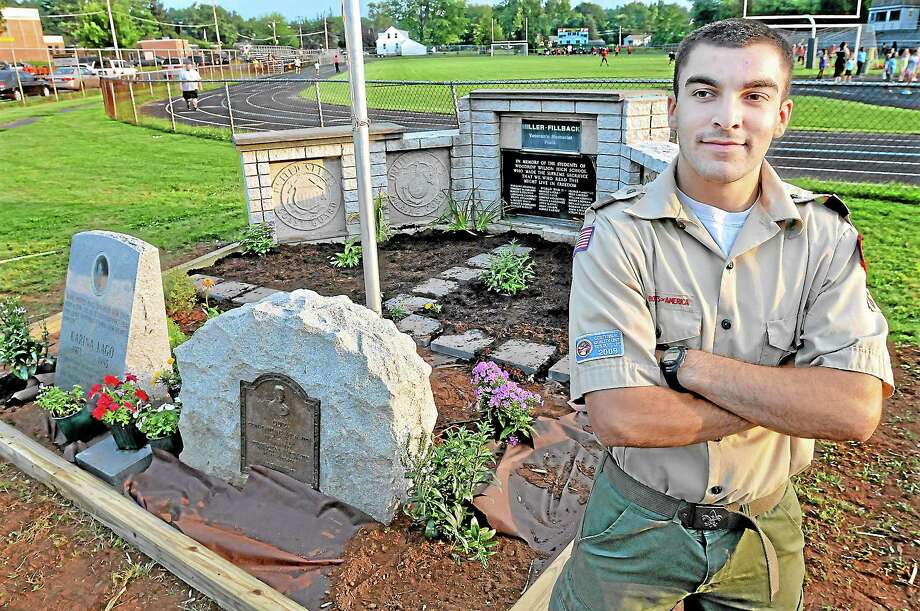 Middletown resident Michael Tewksbury, 17, a member of Boy Scouts Troop 16 chartered by Third Congregational Church, at the site of his Eagle Scout Service Project, the monument area at Miller-Fillback Veterans Memorial Field. Tewksbury, a rising freshman at Norwich University, plans to study computer science and is enrolled in the ROTC program. Catherine Avalone — The Middletown Press Photo: Journal Register Co. / TheMiddletownPress