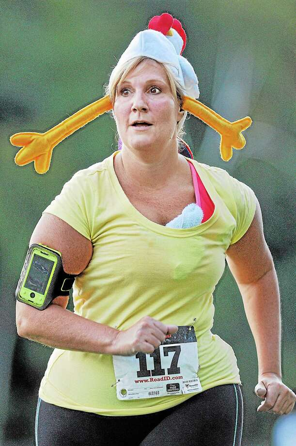 Middletown resident Lynn Ushchak completed the Oddfellows 5K Rubber Chicken Run in 42:31 Thursday evening at Mercy High School. Tom Holowka placed first in 17:18. Results can be viewed www.thelastminleracing.com. A gallery of images can be viewed at media.middletownpress.com.  Catherine Avalone — The Middletown Press Photo: Journal Register Co. / TheMiddletownPress