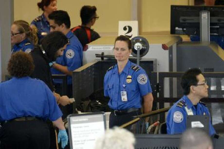 Travelers are screened by Transportation Security Administration agents after Terminal 3 was re-opened a day after a shooting at Los Angeles International Airport November 2, 2013 in Los Angeles, California.