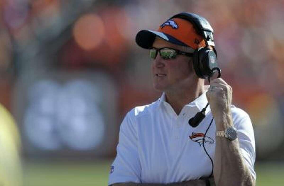 Denver Broncos head coach John Fox looks on against the Washington Redskins during an NFL football game Sunday, Oct. 27, 2013, in Denver.