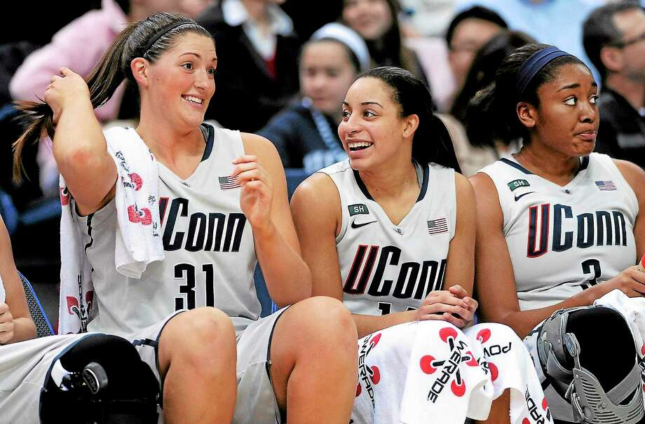 UConn's Stefanie Dolson, left, and Bria Hartley are the two remaining Husky seniors from an original class of five. They will look to lead UConn to back-to-back national titles in their final season. Photo: Fred Beckham — The Associated Press  / AP2013