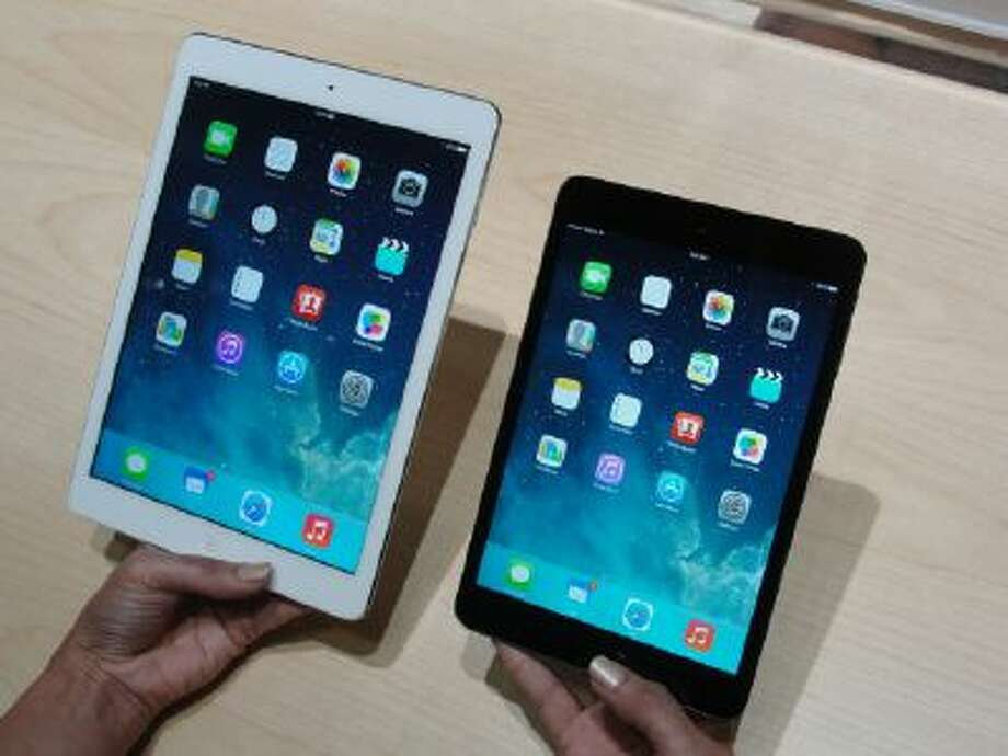 Apple's new iPad Air, left, and iPad Mini tablets are seen on October 22, 2013 in San Francisco, California.