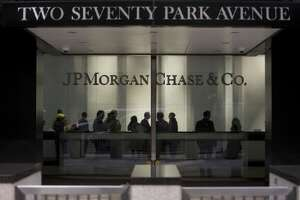 BThe lobby of JP Morgan Chase & Co. headquarters in New York City. The company says it's cooperating with a federal investigation in currency trading.