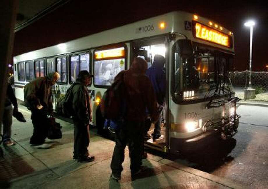 People wait to board the No. 22 VTA bus at about 1:20 a.m. morning, October 25.