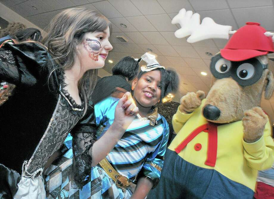 Amya Gibbs, 7, as Frankie from Monster High, at left and the vampire Annabella Fronzaglio, 7, dance with Elroy the Elk, also known as Past Exhalted Ruler Dan Miramant at the Fifth Annual Safe Halloween Party at the Middletown Elks Lodge 771 on Maynard Street Thursday night. Catherine Avalone - The Middletown Press Photo: Journal Register Co. / TheMiddletownPress