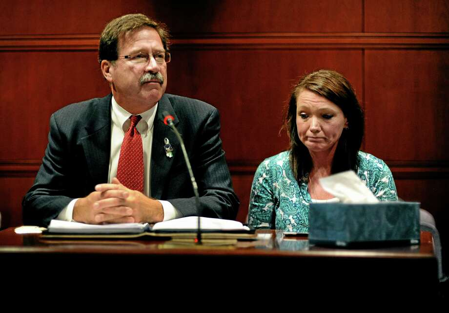 Bill Sherlach, left, husband of Sandy Hook Elementary School shooting victim Mary Sherlach, and Nicole Hockley, mother of victim Dylan Hockley, speak before the Task Force on Victim Privacy and the Publics Right To Know, Wednesday, Oct. 30, 2013, in Hartford, Conn. Sherlach and Hockley told the panel they don't want the 911 tapes from that day released to the public. The Freedom of Information Commission has ordered the release of the 911 recordings, but a prosecutor has said the ruling will be appealed. (AP Photo/Jessica Hill) Photo: AP / FR125654 AP
