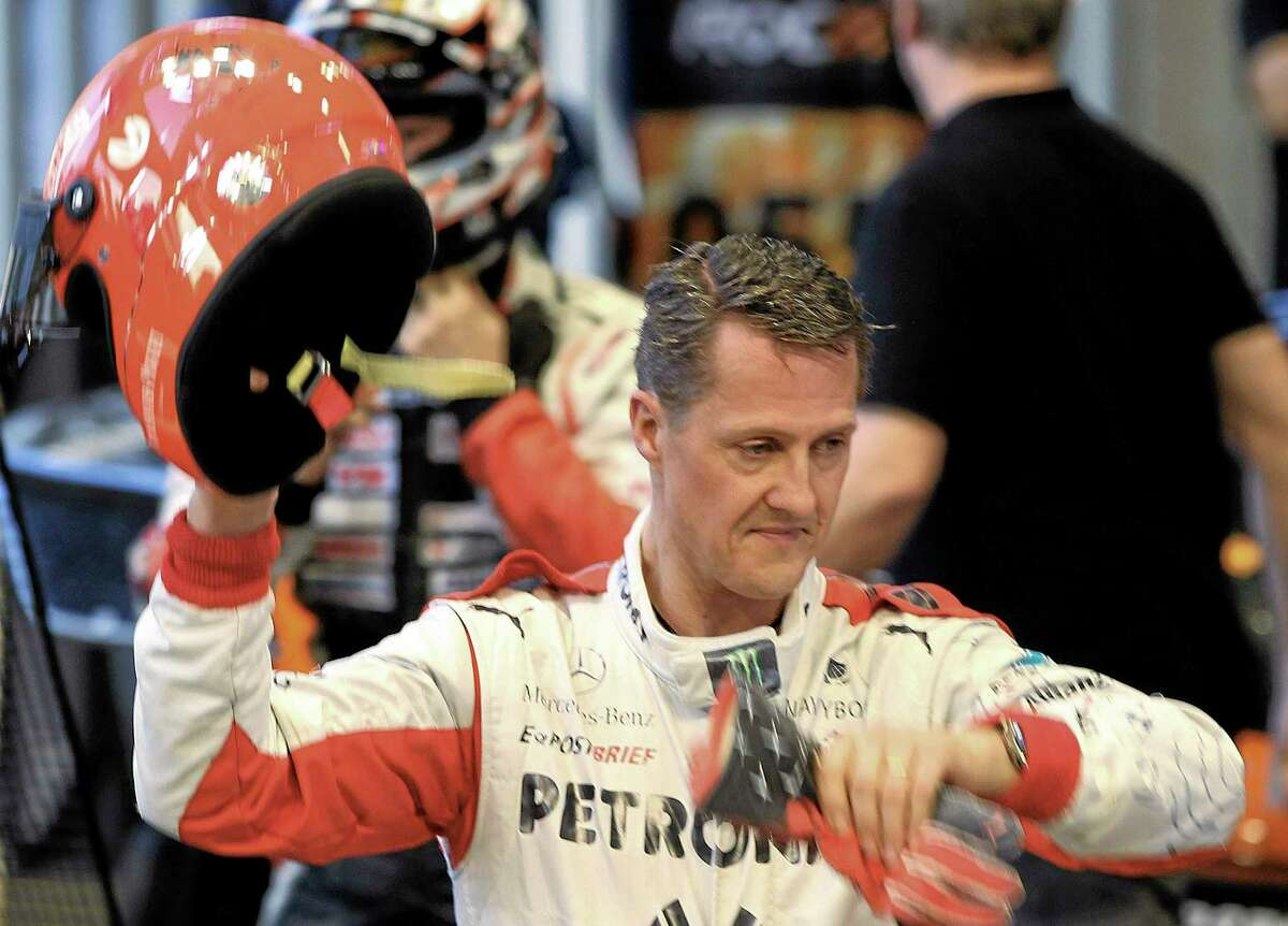 Michael Schumacher, here after a test drive prior to the Race Of Champions in Bangkok, Thailand, has had two surgeries since suffering a life-threatening head injury in a ski accident Sunday in Meribel, France.