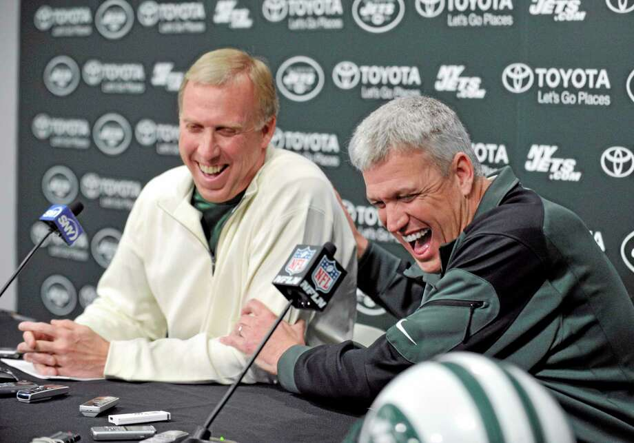 New York Jets coach Rex Ryan, right, and general manager John Idzik speak to the media on Tuesday in Florham Park, N.J. Photo: Bill Kostroun — The Associated Press  / FR51951 AP