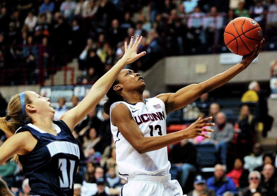 UConn's Brianna Banks drives past Monmouth's Jenny Horvatinovic during the Huskies' Nov. 23 win in Storrs. Photo: Fred Beckham — The Associated Press  / FR153656 AP