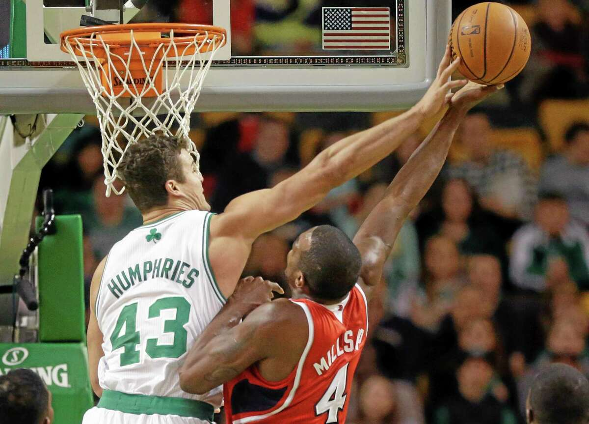 Celtics forward Kris Humphries tries to block Hawks forward Paul Millsap during the first quarter Tuesday at the TD Garden in Boston. Atlanta won 92-91.