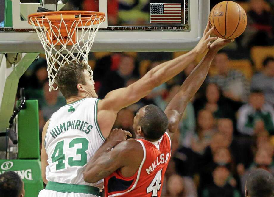 Celtics forward Kris Humphries tries to block Hawks forward Paul Millsap during the first quarter Tuesday at the TD Garden in Boston. Atlanta won 92-91. Photo: Steven Senne — The Associated Press  / AP