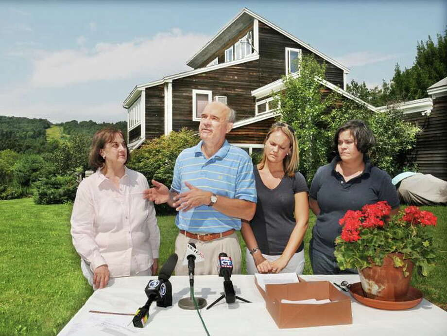 Ken Leavitt and his wife, Tina, and daughters Jennifer and Vivian held a press conference in August 2010 after the town of Middlefield said it would foreclose on the Powder Ridge property and home where the Leavitts were living. The Leavitts ran the ski area from 1997 to 2007. Photo: Catherine Avalone — The Middletown Press  / TheMiddletownPress