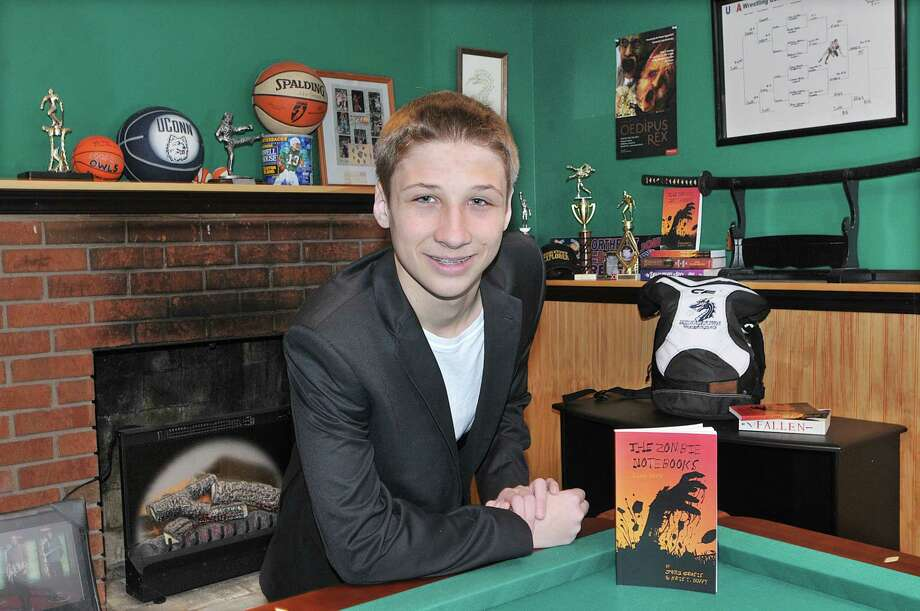"""Fourteen-year-old Middletown resident John Grasis, a freshman at Middletown High School completed his first book, """"The Zombie Notebooks Luke's Story."""" Grasis, a Middletown Police Explorer and varsity wrestler said the setting of the story is local and is planning a series. The book is published by Create Space. Catherine Avalone - The Middletown Press Photo: Journal Register Co. / TheMiddletownPress"""