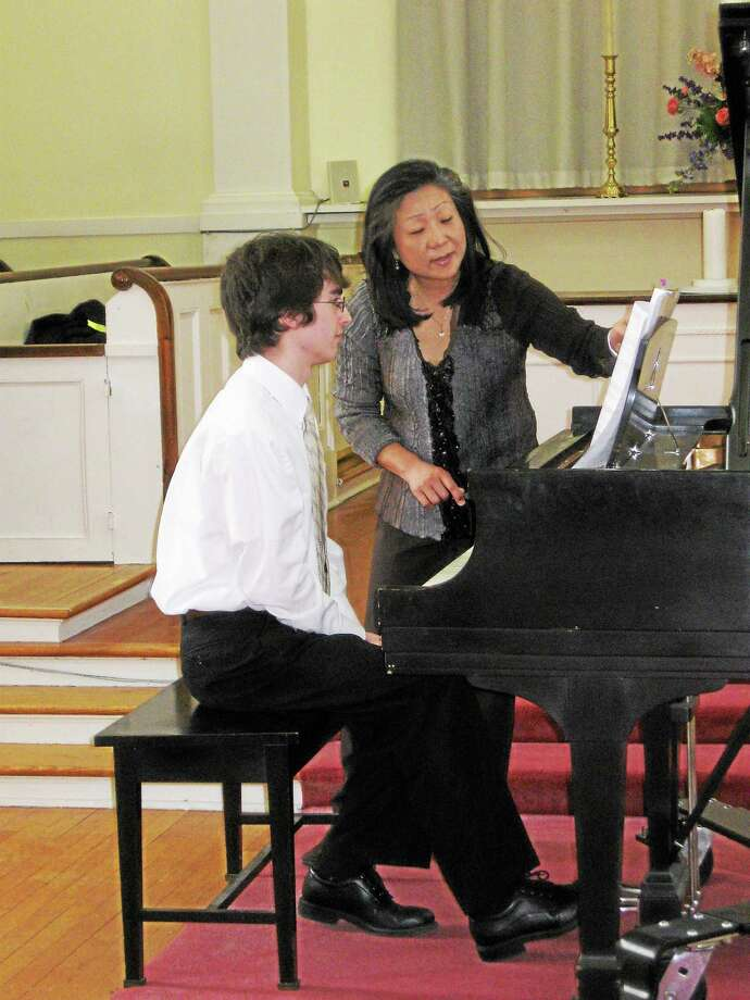 Submitted photo - CMS Mihae Lee works with CMS student Daniel Kurpaska. Photo: Journal Register Co.