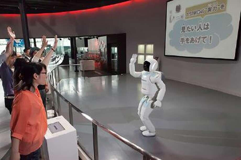 Honda says ASIMO immediately recognizes customers' intentions with a show of hands.