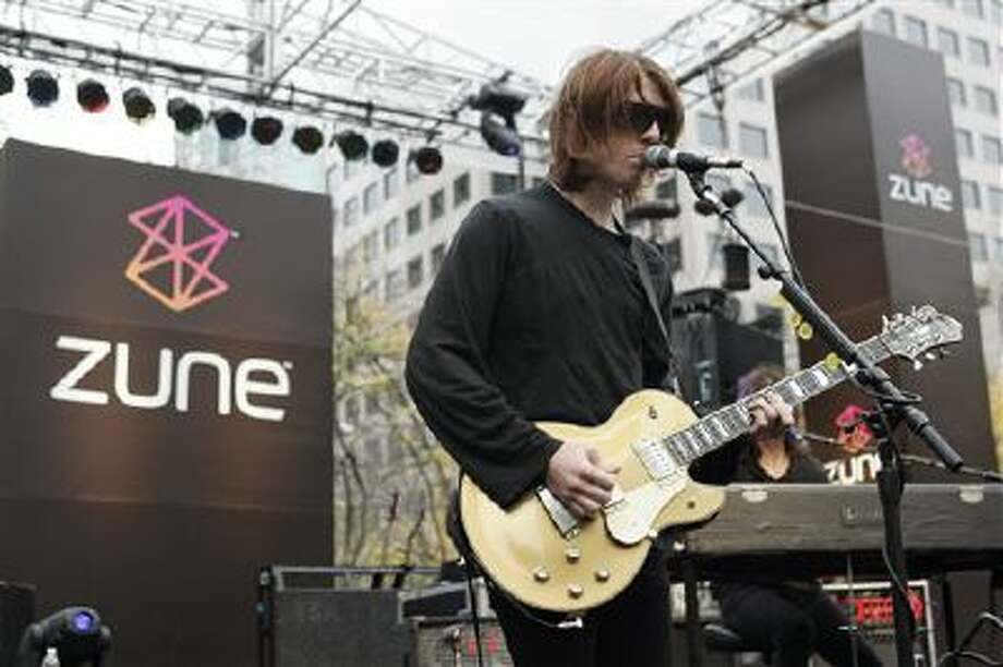 In this Nov. 13, 2006 file photo, Benjamin Curtis with the band Secret Machines performs at a launch party for Microsoft's new music player Zune at Westlake Park in downtown Seattle. Curtis, guitarist and co-founder of the popular indie-rock band School of Seven Bells, has died on Dec. 29, 2013, of cancer. He was 35. Photo: AP / AP