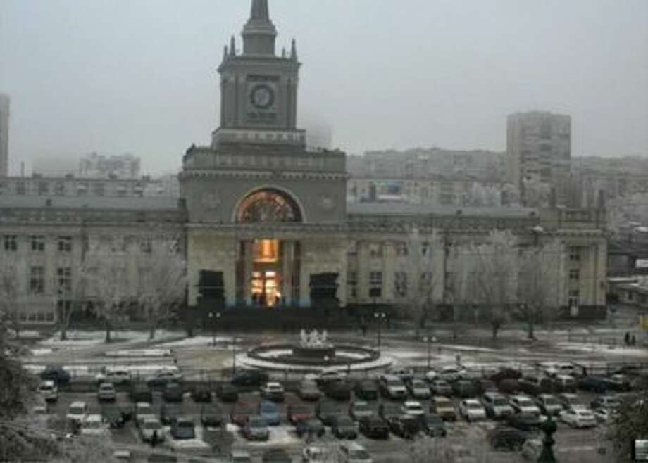 In this photo made by a public camera and made available by the Associated Press Television News the flash of an explosion illuminates the entrance to Volgograd railway station in Russia, Sunday.