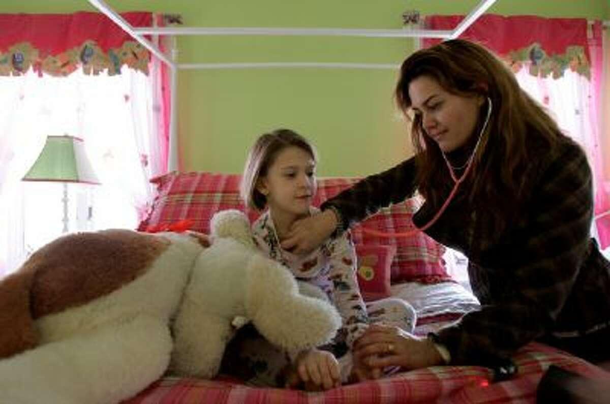 Pediatrician Natalie Hodge makes a house call.