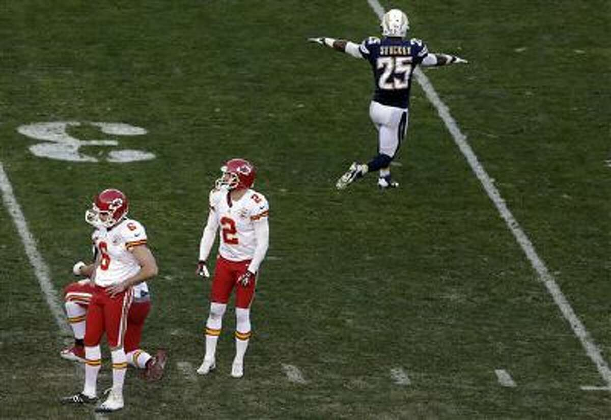 Kansas City Chiefs kicker Ryan Succop, left, looks down after missing a field goal during the last minute of regulation time as San Diego Chargers defensive back Darrell Stuckey, right, reacts during the second half in an NFL football game, Sunday, Dec. 29, 2013, in San Diego.