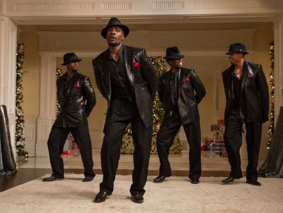 "This image released by Universal Pictures shows, from left, Taye Diggs, Morris Chestnut, Harold Perrineau and Terrence Howard in a scene from ""The Best Man Holiday."""