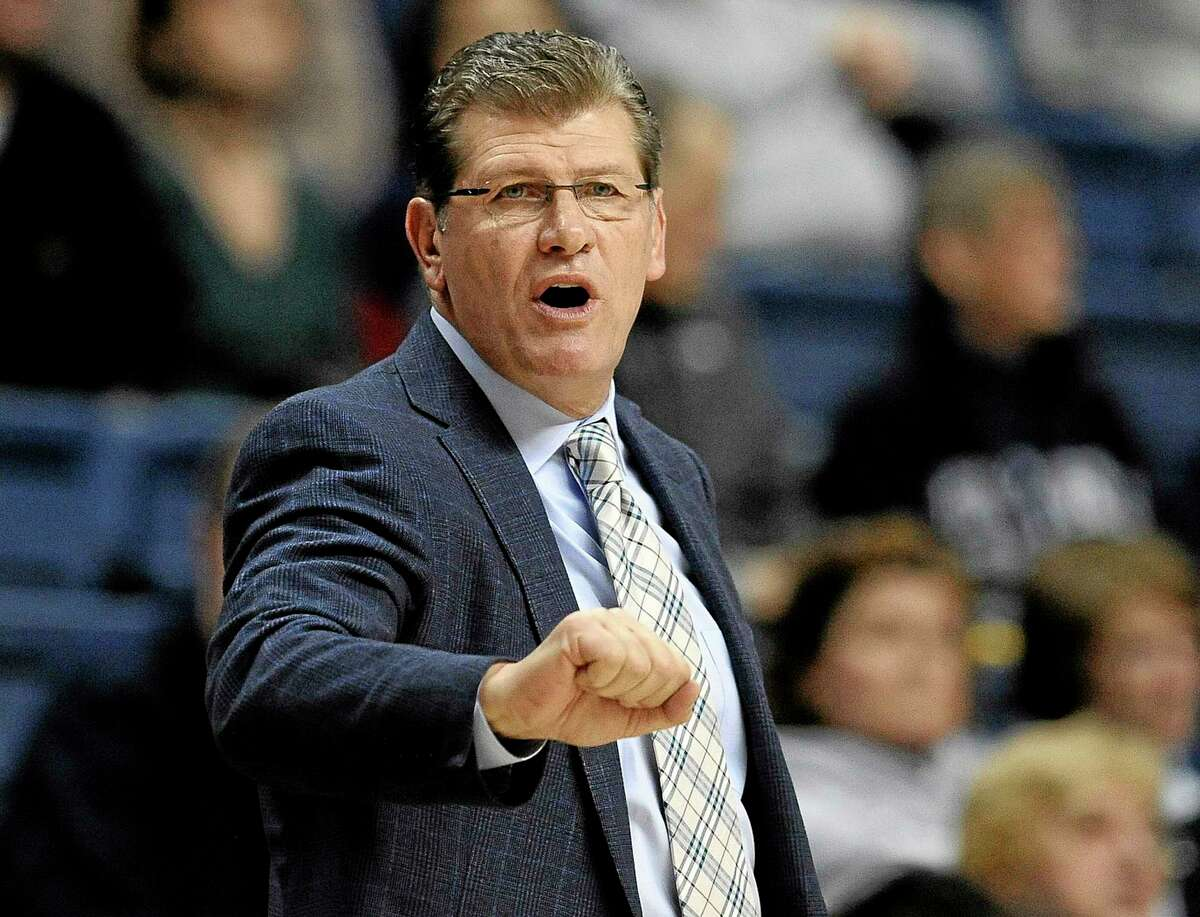 UConn head coach Geno Auriemma gestures toward his team during the first half of Sunday's game against Cincinnati in Storrs.