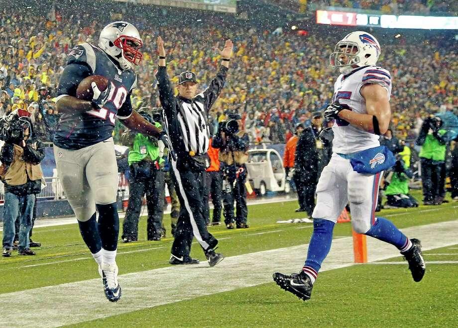 Patriots running back LeGarrette Blount (29) scores a touchdown past Bills safety Jim Leonhard in the second quarter Sunday in Foxborough, Mass. Photo: Elise Amendola — The Associated Press  / AP