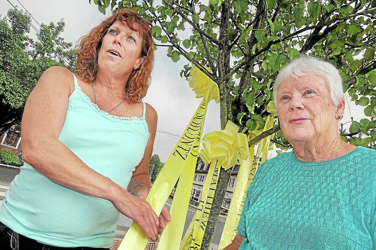 East Hampton resident Donna McLaughlin, left, holds the yellow ribbon for her son, Army Specialist Kurt Schluntz, next to her mother Ann McLaughlin, Schluntz's grandmother, in this July file photo.