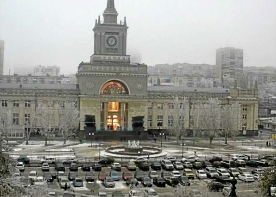 In this photo made by a public camera and made available by the Associated Press Television News the flash of an explosion illuminates the entrance to  Volgograd railway station in Volgograd Russia  on Sunday, Dec. 29, 2013. More then a dozen people were killed and scores were wounded Sunday by a suicide bomber at a railway station in southern Russia, officials said, heightening concern about terrorism ahead of February's Olympics in the Black Sea resort of Sochi. (AP Photo/ Associated Press Television News) Photo: AP / Associared Press Television News