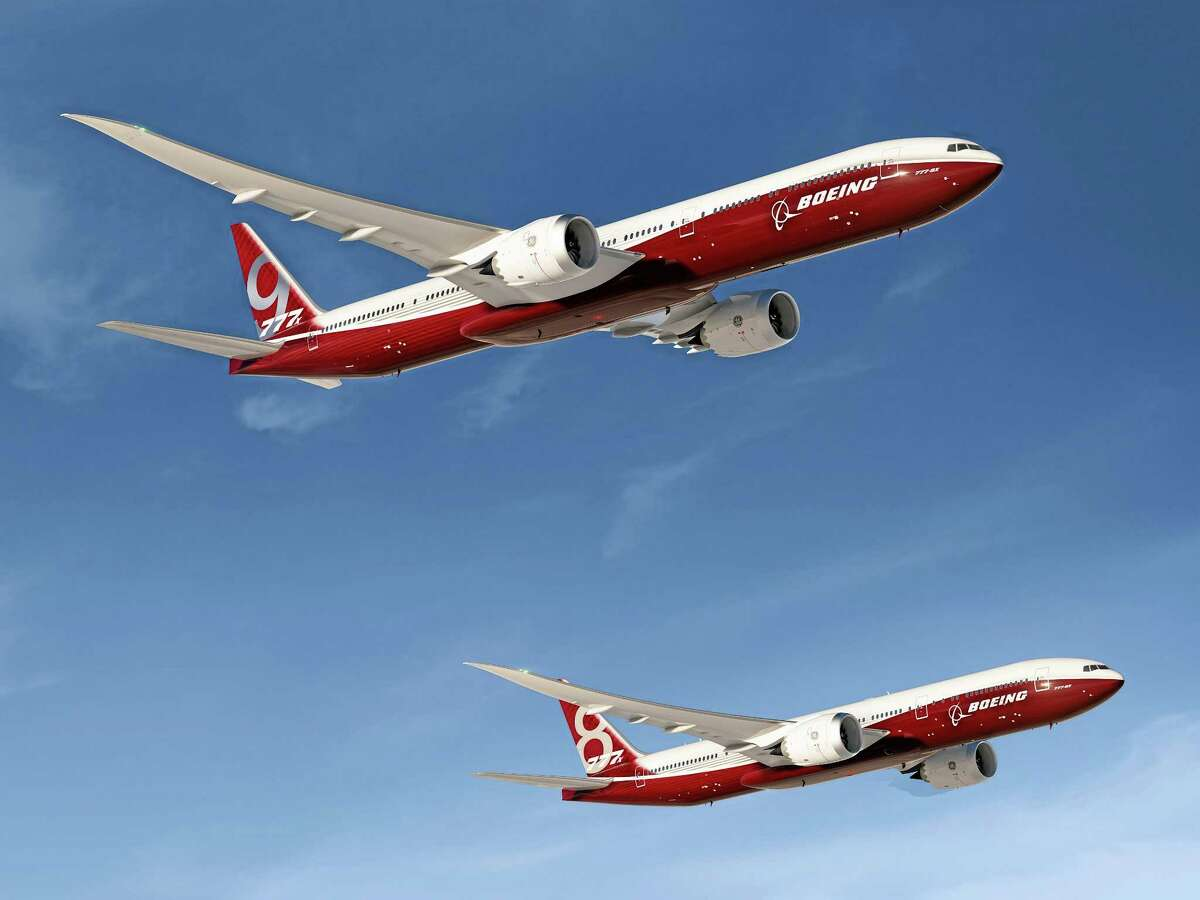 FILE - In this undated artist's concept provided by The Boeing Co., is the aerospace company's new family of 777X jetliners, the 777-9X, top, and 777-8X. Illinois has joined more than 20 states making a pitch to woo the aircraft manufacturer is to move production of its 777x airliners out of Washington state. Illinois may be uniquely unsuited to what Boeing needs because of its strong union presence, lack of any aircraft industry or ocean access. Boeing's list of wants isn't insignificant. It includes an airport location with a 9,000-foot runway (there are only a handful in Illinois) and adjacent rail access, as well as an ocean port. (AP Photo/The Boeing Co. File)