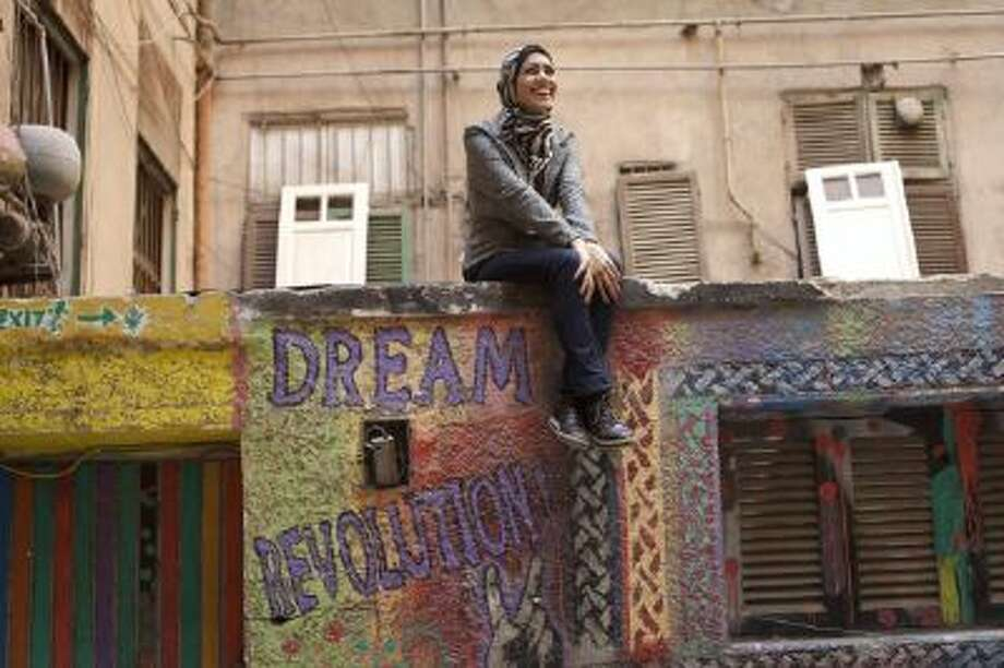 Egyptian rapper Myam Mahmoud poses for a portrait in downtown Cairo.