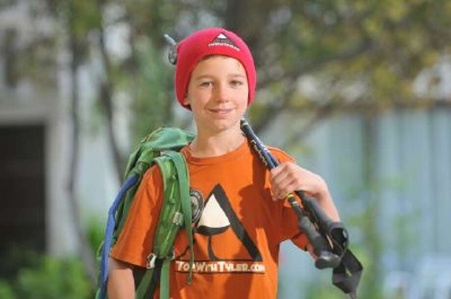 Tyler Armstrong, 9, arrives to a hotel in Mendoza, Argentina on Dec. 27 during a trio in which he became the youngest person in recorded history to reach the summit of Argentina's Aconcagua mountain, the tallest peak in the Western and Southern hemispheres.