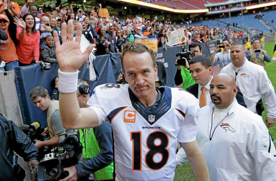 Register columnist Chip Malafronte argues that Dan Marino's 5,084 yards passing and 48 touchdowns in 1984 are a lot more impressive than Peyton Manning's 5,211 yards and 51 touchdowns heading into today's regular season finale. Photo: David J. Phillip — The Associated Press  / AP