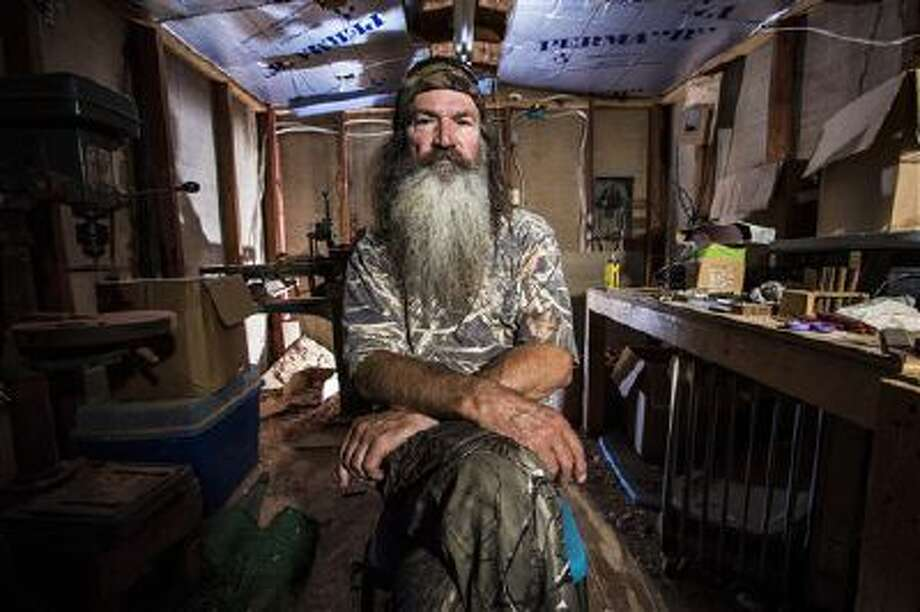 "This undated image released by A&E shows Phil Robertson from the popular series ""Duck Dynasty."" Robertson was suspended for disparaging comments he made to GQ magazine about gay people but was reinstated by the network on Friday, Dec. 27. Photo: AP / A&E"
