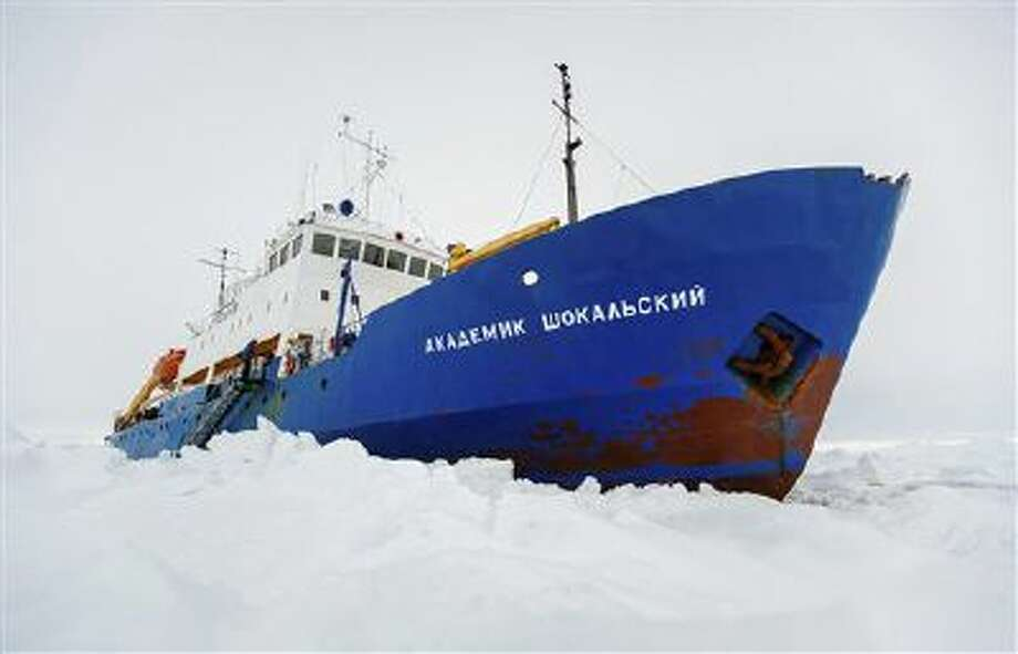 The Russian ship MV Akademik Shokalskiy is trapped in thick Antarctic ice 1,500 nautical miles south of Hobart, Australia, Friday, Dec. 27, 2013. Photo: AP / Australasian Antarctic Expeditio