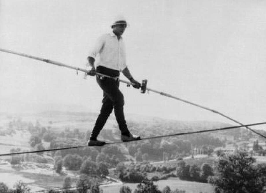 French tightrope walker Henri Rechatin walks over the Saint-Remy sur Durolle countryside in central France, in this July 16, 1967 file photo, as he breaks the specialty's world record of the time.