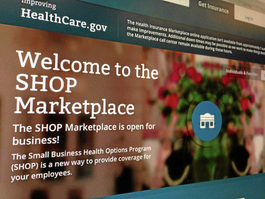 FILE This Nov. 27, 2013 file photo of part of the HealthCare.gov website page featuring information about the SHOP Marketplace is photographed in Washington. Although multiple problems have snarled the rollout of President Barack Obama's signature health care law, it's hardly the first time a new, sprawling government program has been beset by early technical glitches, political hostility and gloom-and-doom denouncements. (AP Photo/Jon Elswick, File) Photo: AP / AP