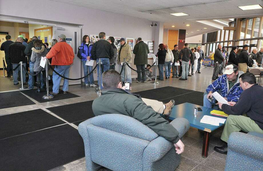 Connecticut gun owners wait in line at the State of Connecticut Department of Public Safety office on Country Club Road in Middletown to register firearms classified as assault weapons under the new regulations established in April in response to the Sandy Hook shooting. The deadline is January 1, 2014. Catherine Avalone - The Middletown Press Photo: Journal Register Co. / TheMiddletownPress