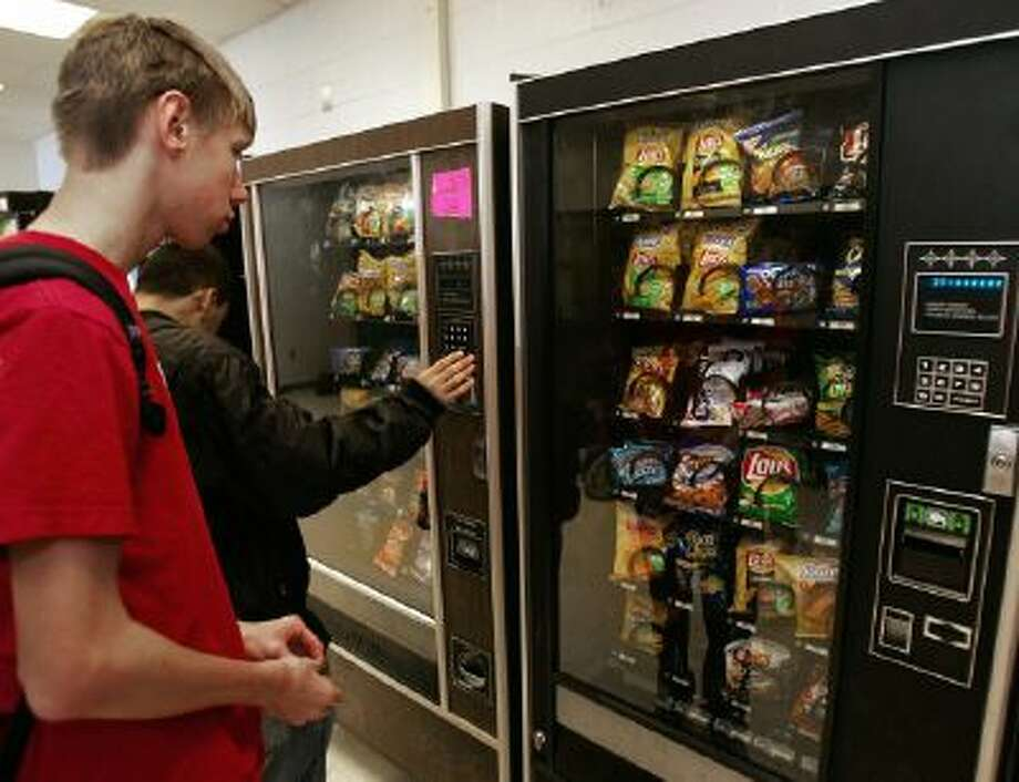 Students at McLean High School in McLean, Virginia, purchase snacks at a vending machine on school property 15 December 2005.