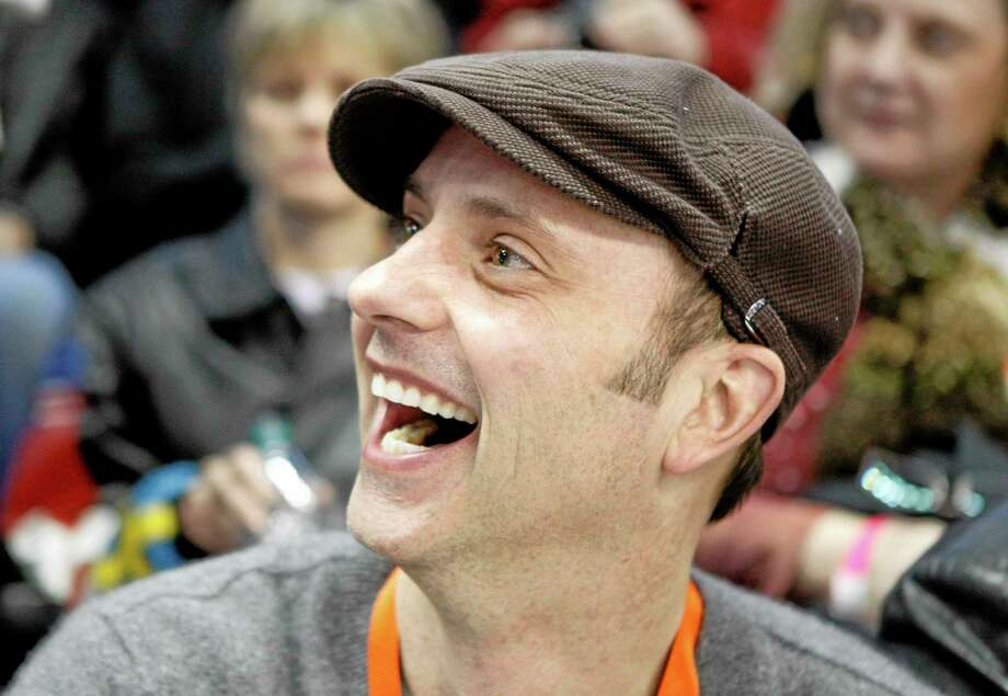 "FILE - In this Jan. 15, 2010 file photo, former Olympian Brian Boitano smiles in the stands during the men's singles competition at the U.S. figure skating championships in Spokane, Wash. Two days after being named to the U.S. delegation for Sochi, Boitano has announced he is gay. But the 1988 gold medalist says Thursday, Dec. 19, 2013,  in a statement that ""being gay is just one part of who I am. ... I hope we can remain focused on the Olympic spirit which celebrates achievement in sport by peoples of all nations."" (AP Photo/Rick Bowmer, File) Photo: AP / AP"