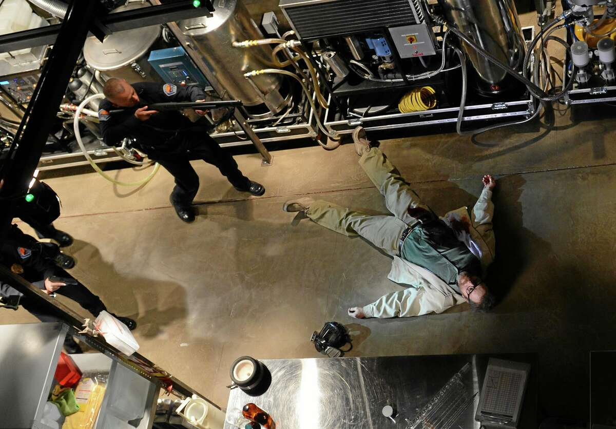 This image released by AMC shows Bryan Cranston, as Walter White, in the final scene from