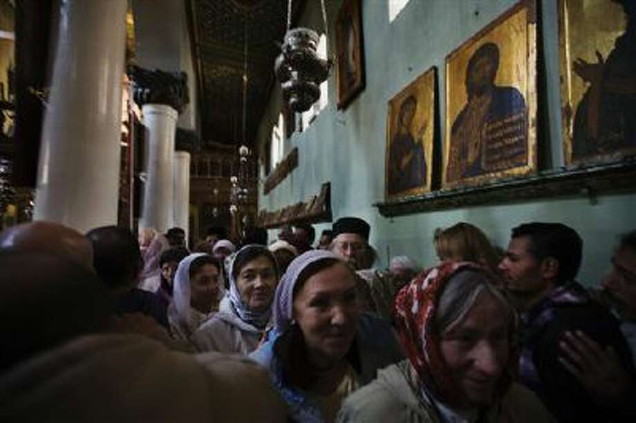 Church-goers leave a service at Saint Catherine's Monastery, also known as Santa Katarina, Dec. 9 at the foot of Mount Sinai in the Sinai peninsula, Egypt. The monastery is Greek Orthodox and is a UNESCO World Heritage Site. Photo: AP / AP