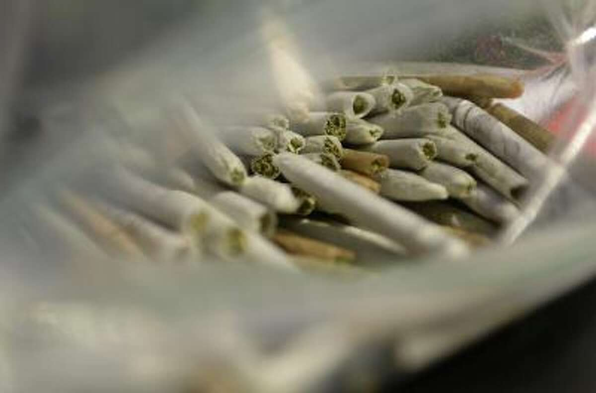 A bag of free marijuana joints were handed out during a rally at Denver Civic Center Park, September 09, 2013.