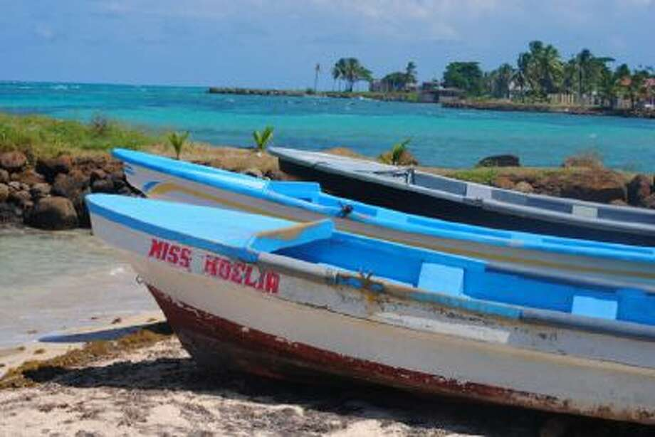 Fishing boats rest on the shore of the Corn Islands. Lobster fishing is a popular trade for islanders.