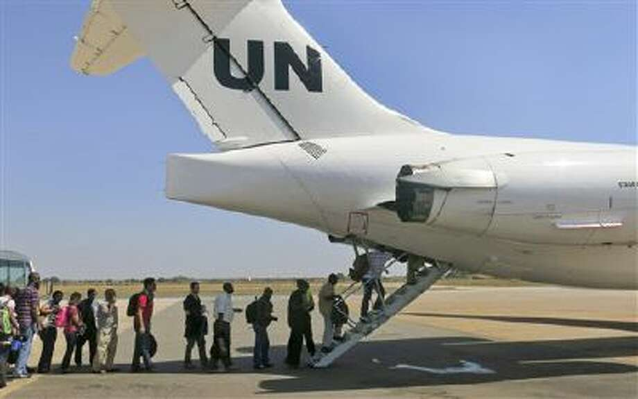The United Nations relocated non-critical staff from Juba, South Sudan, to Entebbe, Uganda, on Sunday. Civilian helicopters evacuated U.S. citizens from the violent South Sudan city of Bor. Photo: ASSOCIATED PRESS / AP2013
